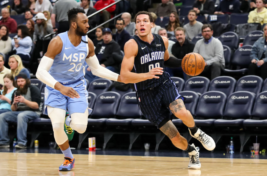 Aaron Gordon of the Orlando Magic dribbles the ball while Josh Okogie of the Minnesota Timberwolves defends. (Photo by David Berding/Getty Images)