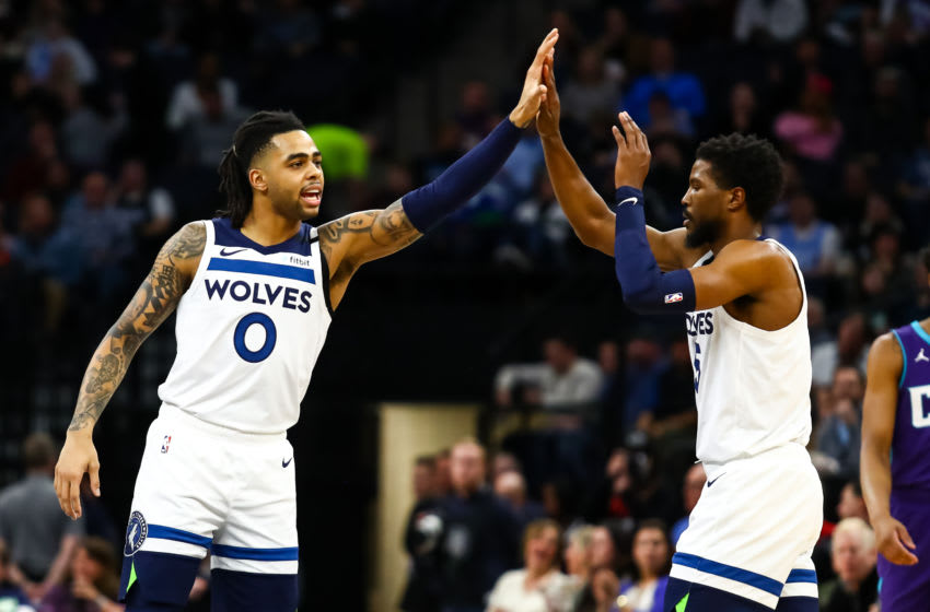 MINNEAPOLIS, MN - FEBRUARY 12: D'Angelo Russell #0 high fives Malik Beasley #5 of the Minnesota Timberwolves during the game against the Charlotte Hornets at Target Center on February 12, 2020 in Minneapolis, Minnesota. The Hornets defeated the Timberwolves 115-108. NOTE TO USER: User expressly acknowledges and agrees that, by downloading and or using this Photograph, user is consenting to the terms and conditions of the Getty Images License Agreement. (Photo by David Berding/Getty Images)