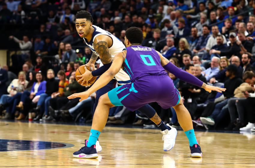 MINNEAPOLIS, MN - FEBRUARY 12: D'Angelo Russell #0 of the Minnesota Timberwolves in action while Miles Bridges #0 of the Charlotte Hornets defends in the third quarter of the game at Target Center on February 12, 2020 in Minneapolis, Minnesota. The Hornets defeated the Timberwolves 115-108. NOTE TO USER: User expressly acknowledges and agrees that, by downloading and or using this Photograph, user is consenting to the terms and conditions of the Getty Images License Agreement. (Photo by David Berding/Getty Images)