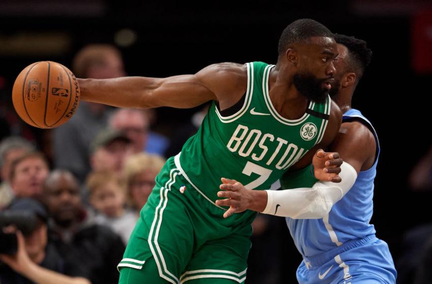 MINNEAPOLIS, MINNESOTA - FEBRUARY 21: Josh Okogie #20 of the Minnesota Timberwolves defends against Jaylen Brown #7 of the Boston Celtics. (Photo by Hannah Foslien/Getty Images)