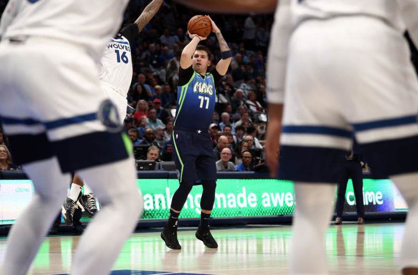 DALLAS, TEXAS - FEBRUARY 24: Luka Doncic #77 of the Dallas Mavericks takes a shot against the Minnesota Timberwolves. (Photo by Ronald Martinez/Getty Images)