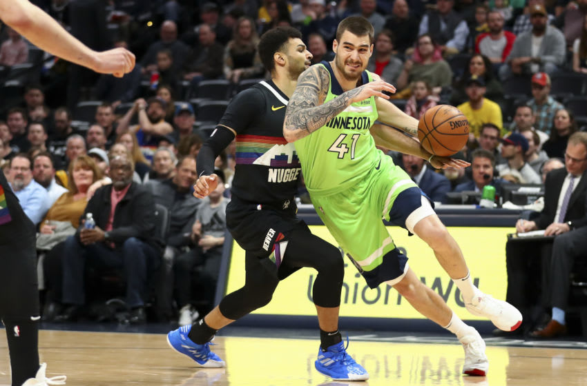 Juancho Hernangomez of the Minnesota Timberwolves drives to the basket against Jamal Murray of the Denver Nuggets. (Photo by Justin Tafoya/Getty Images)