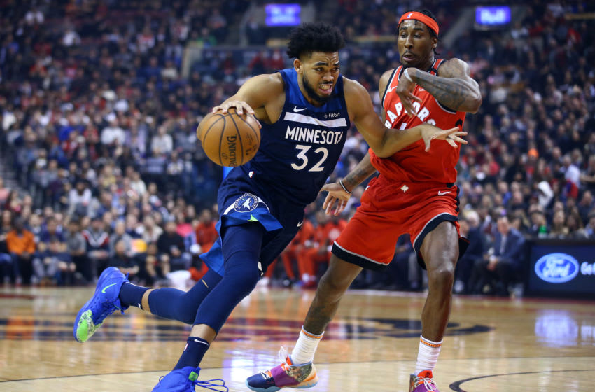 Potential Minnesota Timberwolves free agent target Rondae Hollis-Jefferson guards Karl-Anthony Towns. (Photo by Vaughn Ridley/Getty Images)