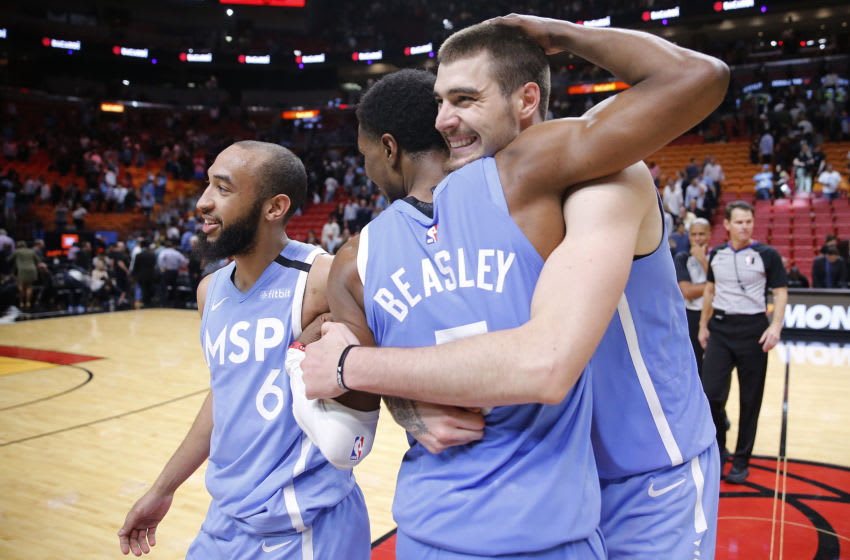 MIAMI, FLORIDA - FEBRUARY 26: Juan Hernangomez hugs Malik Beasley after they defeated the Miami Heat. (Photo by Michael Reaves/Getty Images)