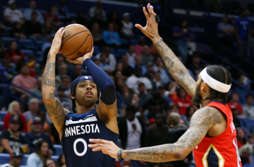 NEW ORLEANS, LOUISIANA - MARCH 03: D'Angelo Russell #0 of the Minnesota Timberwolves shoots against Brandon Ingram #14 of the New Orleans Pelicans. (Photo by Jonathan Bachman/Getty Images)