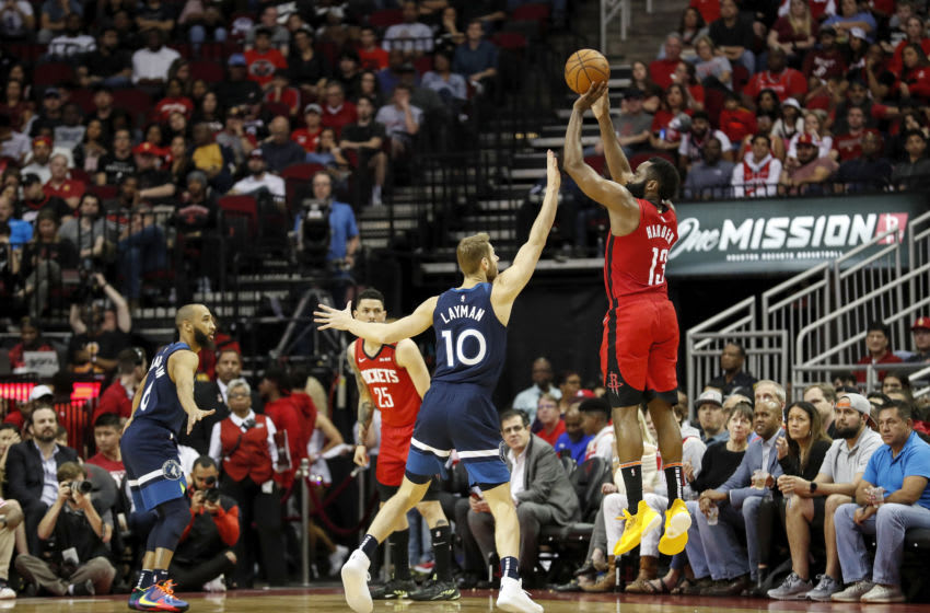 HOUSTON, TEXAS - MARCH 10: James Harden #13 of the Houston Rockets takes a three point shot while defended by Jake Layman #10 of the Minnesota Timberwolves. (Photo by Tim Warner/Getty Images)