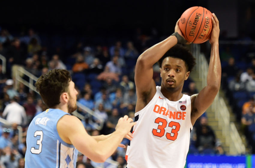 GREENSBORO, NORTH CAROLINA - MARCH 11: Elijah Hughes #33 of the Syracuse Orange looks to pass against Andrew Platek #3 of the North Carolina Tar Heels during their game in the second round of the 2020 Men's ACC Basketball Tournament at Greensboro Coliseum on March 11, 2020 in Greensboro, North Carolina. (Photo by Jared C. Tilton/Getty Images)