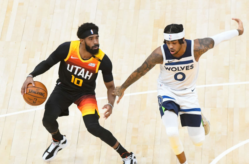 D'Angelo Russell of the Minnesota Timberwolves guards Mike Conley of the Utah Jazz. (Photo by Alex Goodlett/Getty Images)