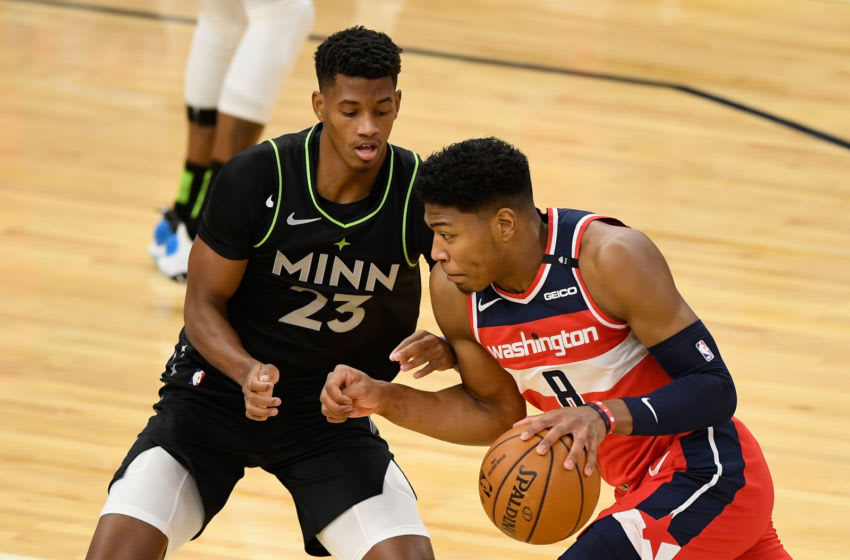 MINNEAPOLIS, MINNESOTA - JANUARY 01: Jarrett Culver #23 of the Minnesota Timberwolves defends against Rui Hachimura #8 of the Washington Wizards during the first quarter of the game at Target Center on January 1, 2021 in Minneapolis, Minnesota. The Wizards defeated the Timberwolves 130-109. NOTE TO USER: User expressly acknowledges and agrees that, by downloading and or using this Photograph, user is consenting to the terms and conditions of the Getty Images License Agreement (Photo by Hannah Foslien/Getty Images)