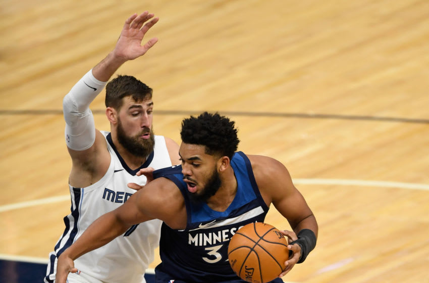 Jonas Valanciunas of the Memphis Grizzlies defends against Karl-Anthony Towns of the Minnesota Timberwolves. (Photo by Hannah Foslien/Getty Images)