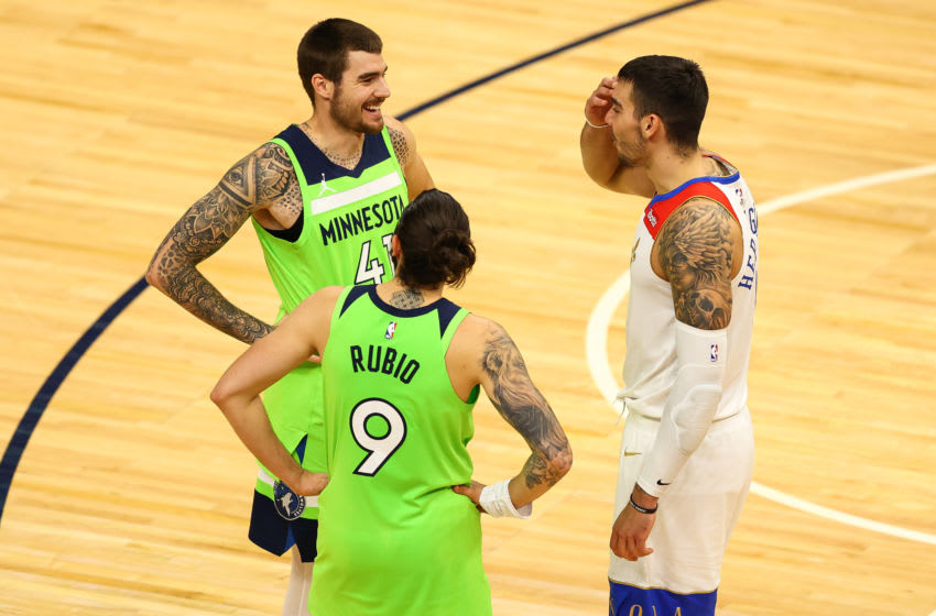 MINNEAPOLIS, MN - MAY 01: Juancho Hernangomez #41 and Ricky Rubio #9 of the Minnesota Timberwolves and Willy Hernangomez #9 of the New Orleans Pelicans talk following the game at Target Center on May 1, 2021 in Minneapolis, Minnesota. NOTE TO USER: User expressly acknowledges and agrees that, by downloading and or using this photograph, User is consenting to the terms and conditions of the Getty Images License Agreement. (Photo by Harrison Barden/Getty Images)