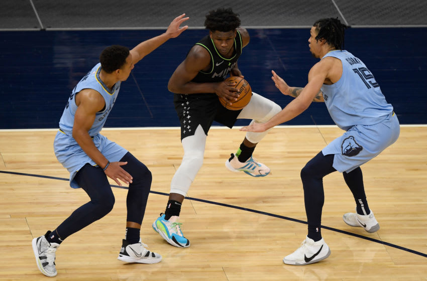 The Memphis Grizzlies swarmed Minnesota Timberwolves rookie Anthony Edwards but they could not slow him down. (Photo by Hannah Foslien/Getty Images)