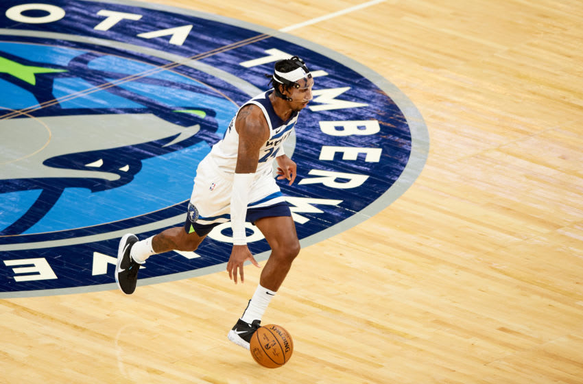 MINNEAPOLIS, MINNESOTA - DECEMBER 14: Rondae Hollis-Jefferson #24 of the Minnesota Timberwolves dribbles the ball against the Memphis Grizzlies during the preseason game at Target Center on December 14, 2020 in Minneapolis, Minnesota. The Grizzlies defeated the Timberwolves 123-104. NOTE TO USER: User expressly acknowledges and agrees that, by downloading and or using this Photograph, user is consenting to the terms and conditions of the Getty Images License Agreement (Photo by Hannah Foslien/Getty Images)