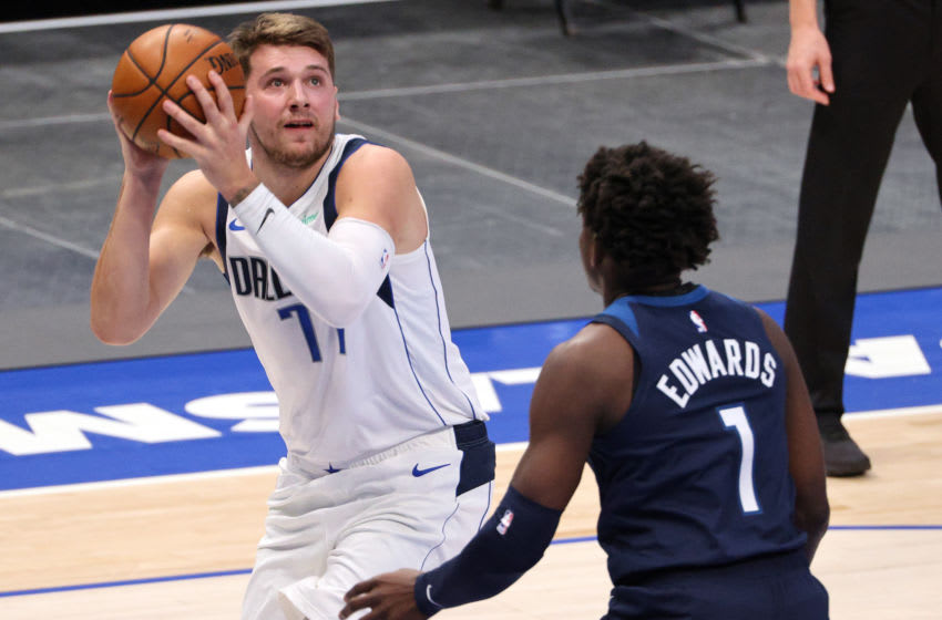Luka Doncic of the Dallas Mavericks takes a shot against Anthony Edwards of the Minnesota Timberwolves. (Photo by Ronald Martinez/Getty Images)