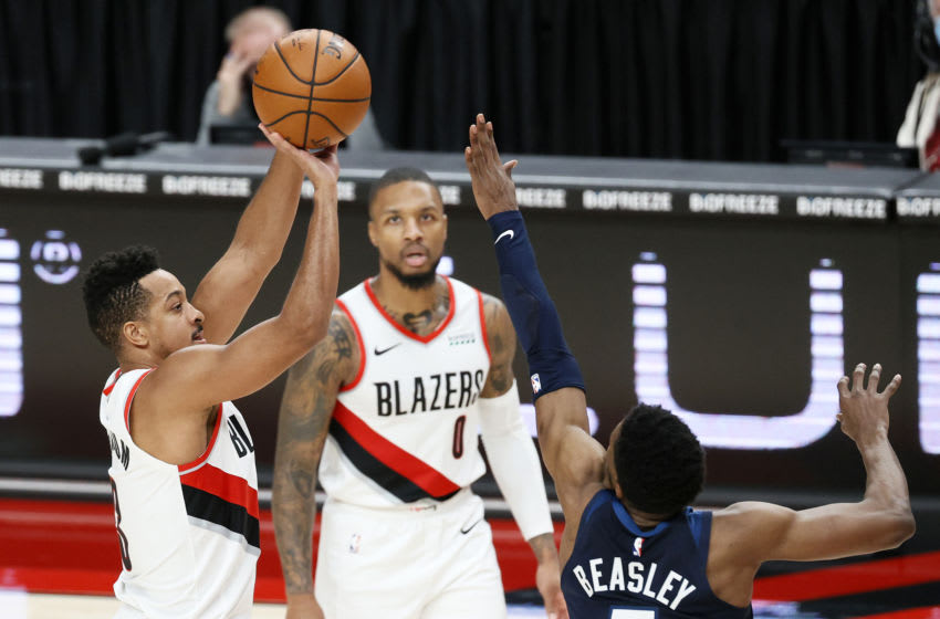CJ McCollum of the Portland Trail Blazers shoots over Malik Beasley of the Minnesota Timberwolves. (Photo by Steph Chambers/Getty Images)
