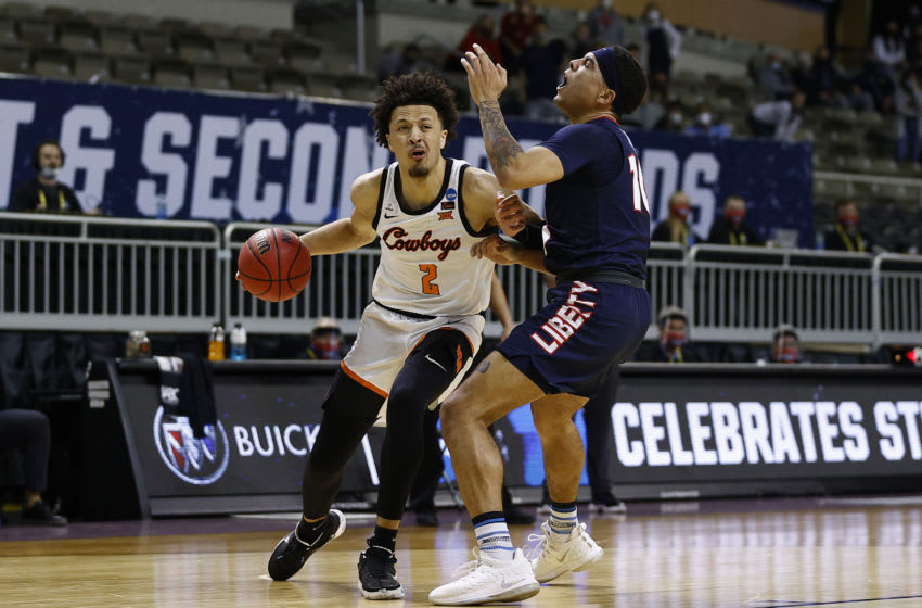 INDIANAPOLIS, INDIANA - MARCH 19: Cade Cunningham #2 of the Oklahoma State Cowboys drives past Elijah Cuffee #10 of the Liberty Flames during the second half the first round game of the 2021 NCAA Men's Basketball Tournament at Indiana Farmers Coliseum on March 19, 2021 in Indianapolis, Indiana. (Photo by Maddie Meyer/Getty Images)