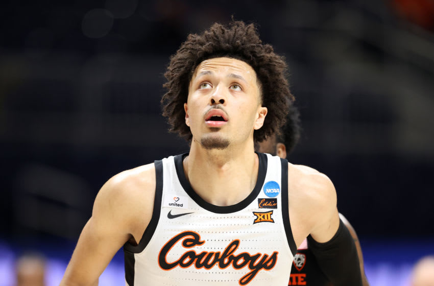 INDIANAPOLIS, INDIANA - MARCH 21: Cade Cunningham #2 of the Oklahoma State Cowboys watches a shot as they take on the Oregon State Beavers during the first half in the second round game of the 2021 NCAA Men's Basketball Tournament at Hinkle Fieldhouse on March 21, 2021 in Indianapolis, Indiana. (Photo by Andy Lyons/Getty Images)