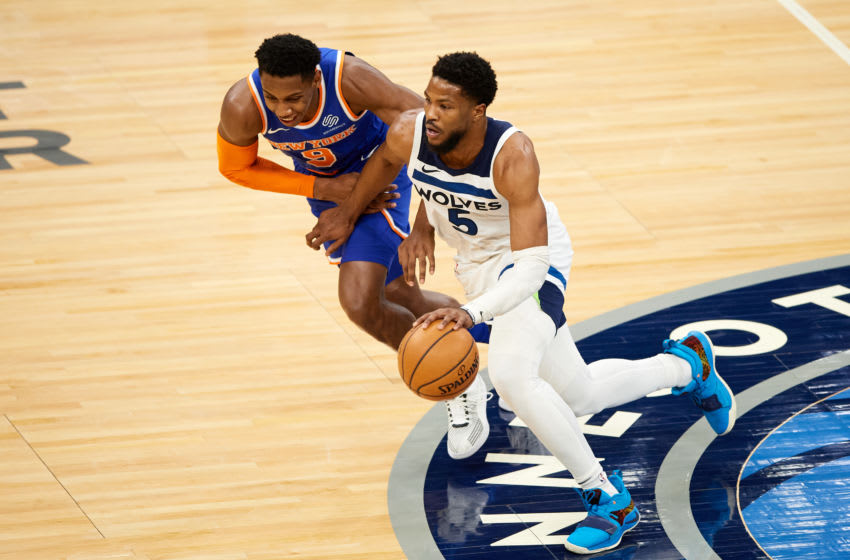 MINNEAPOLIS, MINNESOTA - MARCH 31: RJ Barrett #9 of the New York Knicks defends against Malik Beasley #5 of the Minnesota Timberwolves during the game at Target Center on March 31, 2021 in Minneapolis, Minnesota. The Timberwolves defeated the Knicks 102-101. NOTE TO USER: User expressly acknowledges and agrees that, by downloading and or using this Photograph, user is consenting to the terms and conditions of the Getty Images License Agreement (Photo by Hannah Foslien/Getty Images)