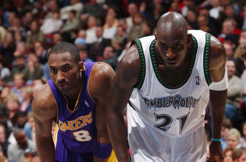 MINNEAPOLIS -JANUARY 6: Kobe Bryant #8 of the Los Angeles Lakers stands next to Kevin Garnett #21 of the Minnesota Timberwolves. (Photo by Andrew D. Bernstein/NBAE via Getty Images)