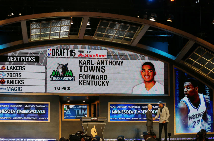 Karl-Anthony Towns meets with Commissioner Adam Silver after being drafted first overall by the Minnesota Timberwolves. (Photo by Elsa/Getty Images)