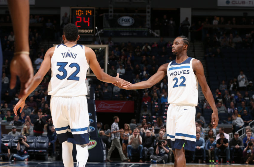MINNEAPOLIS, MN - OCTOBER 24: Karl-Anthony Towns #32 and Andrew Wiggins #22 of the Minnesota Timberwolves high five during the game against the Indiana Pacers on October 24, 2017 at Target Center in Minneapolis, Minnesota. NOTE TO USER: User expressly acknowledges and agrees that, by downloading and or using this Photograph, user is consenting to the terms and conditions of the Getty Images License Agreement. Mandatory Copyright Notice: Copyright 2017 NBAE (Photo by David Sherman/NBAE via Getty Images)