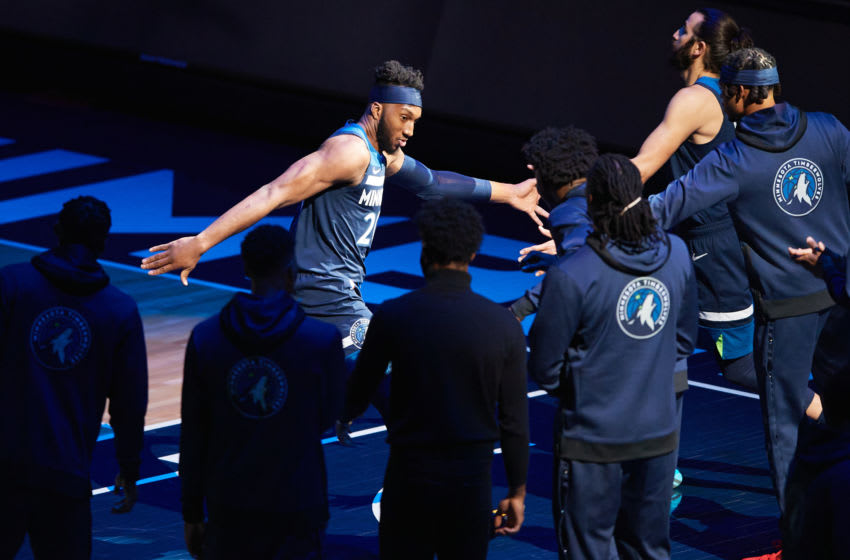 MINNEAPOLIS, MINNESOTA - DECEMBER 23: Josh Okogie #20 of the Minnesota Timberwolves is seen during player introductions before the season opening game at Target Center on December 23, 2020 in Minneapolis, Minnesota. The Timberwolves defeated the Pistons 111-101. NOTE TO USER: User expressly acknowledges and agrees that, by downloading and or using this Photograph, user is consenting to the terms and conditions of the Getty Images License Agreement (Photo by Hannah Foslien/Getty Images)