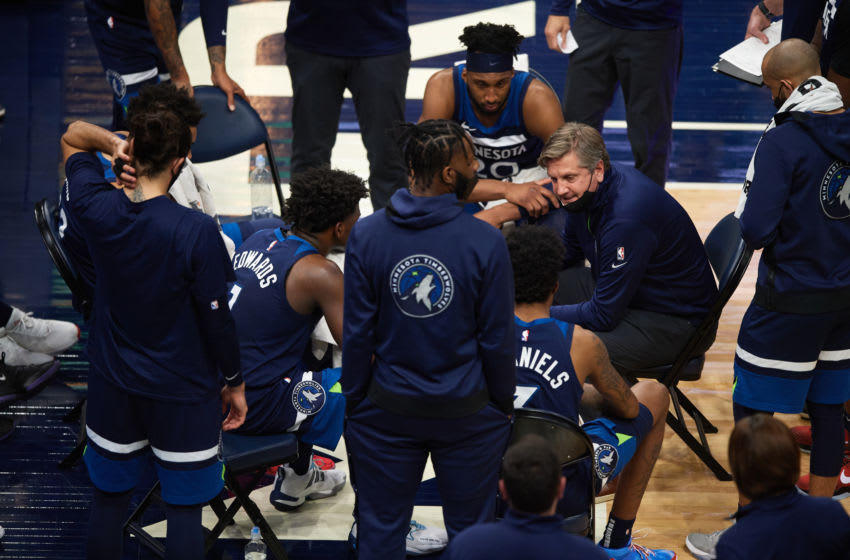 MINNEAPOLIS, MINNESOTA - APRIL 26: Head coach Chris Finch of the Minnesota Timberwolves speaks to his players during a timeout in the fourth quarter of the game against the Utah Jazz at Target Center on April 26, 2021 in Minneapolis, Minnesota. The Timberwolves defeated the Jazz 105-104. NOTE TO USER: User expressly acknowledges and agrees that, by downloading and or using this Photograph, user is consenting to the terms and conditions of the Getty Images License Agreement (Photo by Hannah Foslien/Getty Images)