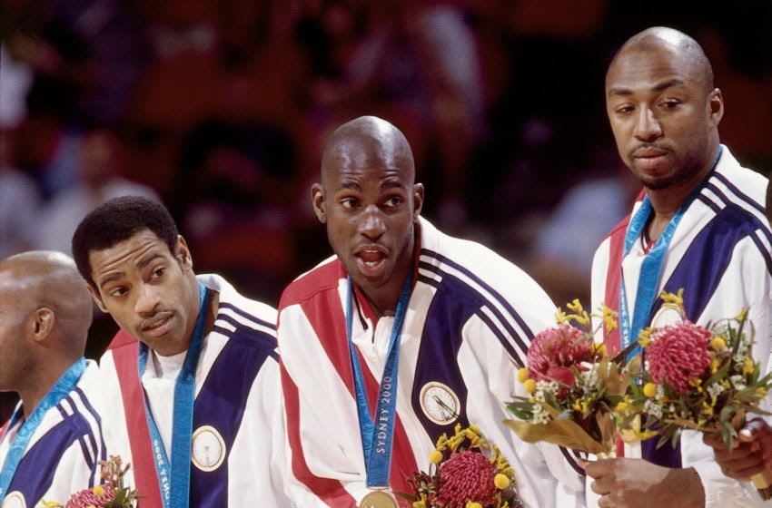 SYDNEY - SEPTEMBER 30: Members of the United States National team (L-R) Vince Carter, Kevin Garnett and Vin Baker pose with their gold medals. Copyright 2000 NBAE (Photo by Andrew D. Bernstein/NBAE via Getty Images)