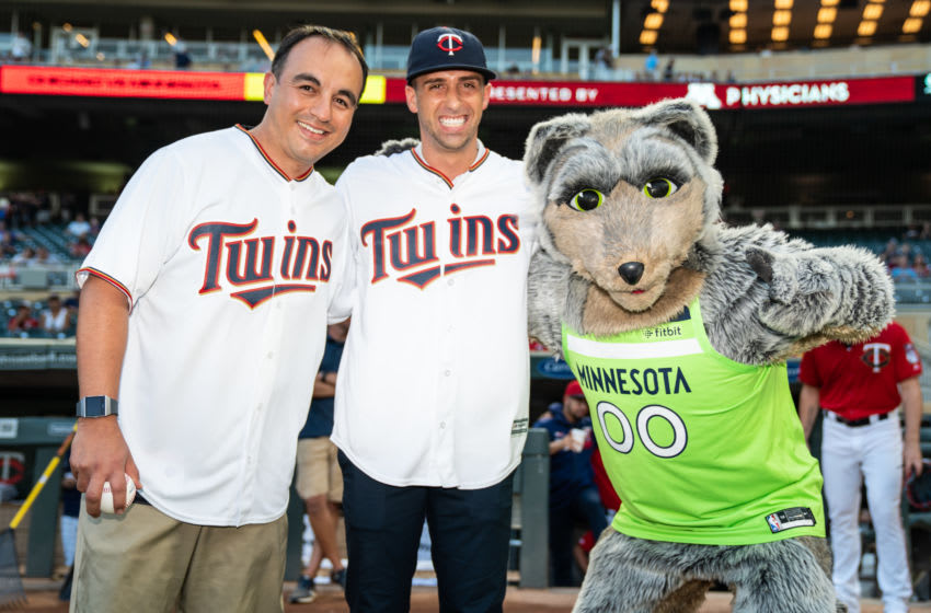 MINNEAPOLIS, MN - SEPTEMBER 17: President of Basketball Operations Gersson Rosas and head coach Ryan Saunders of the Minnesota Timberwolves pose for a photo with mascot Crunch prior to the game between the Minnesota Twins and Chicago White Sox on September 17, 2019 at the Target Field in Minneapolis, Minnesota. (Photo by Brace Hemmelgarn/Minnesota Twins/Getty Images)