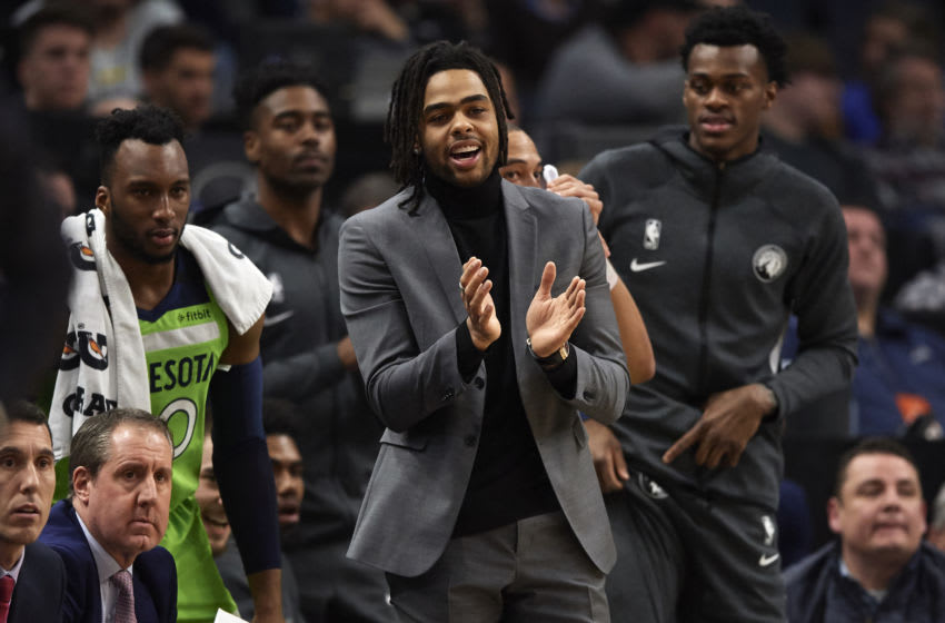 MINNEAPOLIS, MINNESOTA - FEBRUARY 08: D'Angelo Russell #0 of the Minnesota Timberwolves cheers on the team from the bench during the first half of the game against the Los Angeles Clippers at Target Center on February 8, 2020 in Minneapolis, Minnesota. NOTE TO USER: User expressly acknowledges and agrees that, by downloading and or using this Photograph, user is consenting to the terms and conditions of the Getty Images License Agreement (Photo by Hannah Foslien/Getty Images)