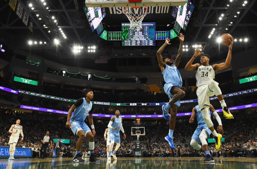MILWAUKEE, WISCONSIN - JANUARY 01: Giannis Antetokounmpo #34 of the Milwaukee Bucks is defended by Josh Okogie #20 of the Minnesota Timberwolves during a game at Fiserv Forum on January 01, 2020 in Milwaukee, Wisconsin. NOTE TO USER: User expressly acknowledges and agrees that, by downloading and or using this photograph, User is consenting to the terms and conditions of the Getty Images License Agreement. (Photo by Stacy Revere/Getty Images)