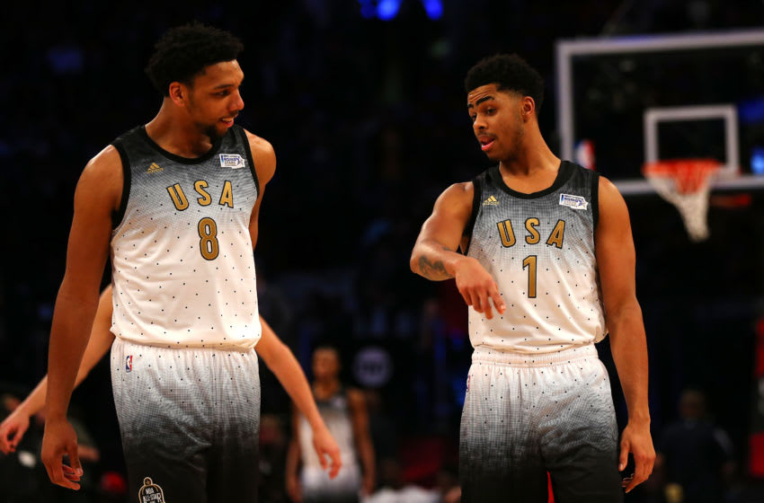 TORONTO, ON - FEBRUARY 12: Jahlil Okafor #8 of the Philadelphia Sixers and D'Angelo Russell #1 of the Los Angeles Lakers and the United States team talk on court in the second half against the World team during the BBVA Compass Rising Stars Challenge 2016 at Air Canada Centre on February 12, 2016 in Toronto, Canada. NOTE TO USER: User expressly acknowledges and agrees that, by downloading and/or using this Photograph, user is consenting to the terms and conditions of the Getty Images License Agreement. (Photo by Elsa/Getty Images)