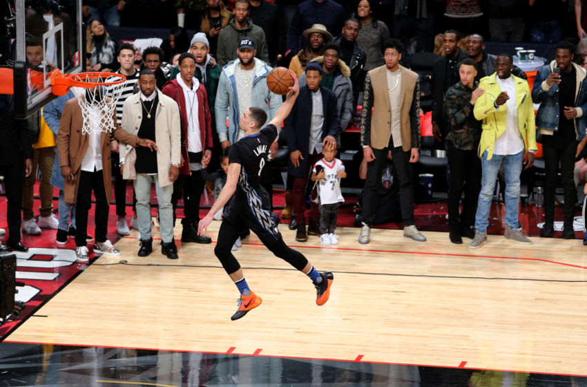Zach LaVine of the Minnesota Timberwolves dunks as NBA players look on in the Verizon Slam Dunk Contest. (Photo by Vaughn Ridley/Getty Images)