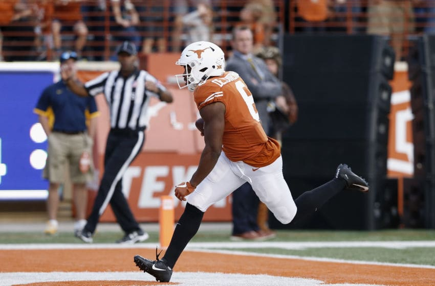 AUSTIN, TX - NOVEMBER 03: Devin Duvernay #6 of the Texas Longhorns catches a pass for a touchdown in the second half against the West Virginia Mountaineers at Darrell K Royal-Texas Memorial Stadium on November 3, 2018 in Austin, Texas. (Photo by Tim Warner/Getty Images)