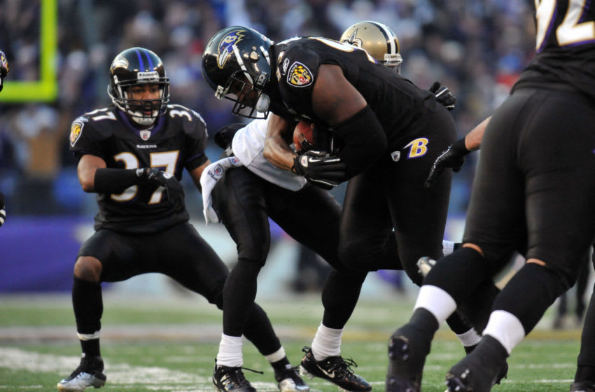 BALTIMORE, MD - DECEMBER 19: Cory Redding #93 of the Baltimore Ravens holds onto the ball after an interception with 1 minute, 56 seconds to go in the game against the New Orleans Saints at M&T Bank Stadium on December 19, 2010 in Baltimore, Maryland. The Ravens defeated the Saints 30-24. (Photo by Larry French/Getty Images)