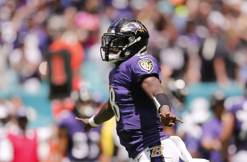 MIAMI, FLORIDA - SEPTEMBER 08: Lamar Jackson #8 of the Baltimore Ravens celebrates after throwing a 47-yard touchdown to Marquise Brown #15 (not pictured) during the first quarter against the Miami Dolphins at Hard Rock Stadium on September 08, 2019 in Miami, Florida. (Photo by Michael Reaves/Getty Images)