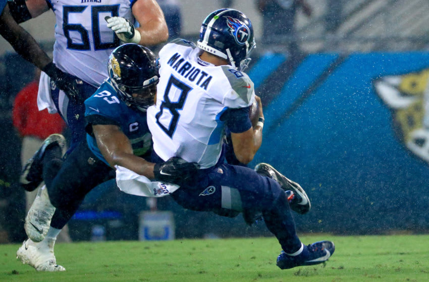 JACKSONVILLE, FLORIDA - SEPTEMBER 19: Marcus Mariota #8 of the Tennessee Titans is tackled by Calais Campbell #93 of the Jacksonville Jaguars during a game at TIAA Bank Field on September 19, 2019 in Jacksonville, Florida. (Photo by Mike Ehrmann/Getty Images)
