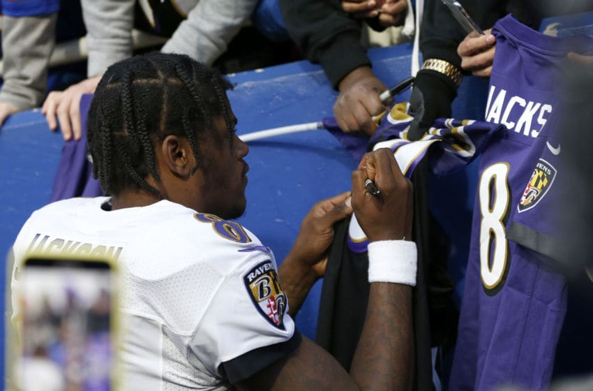 ORCHARD PARK, NY - DECEMBER 8: Lamar Jackson #8 of the Baltimore Ravens signs autographs for fans after a game against the Buffalo Bills at New Era Field on December 8, 2019 in Orchard Park, New York. Baltimore beats Buffalo 24 to 17. (Photo by Timothy T Ludwig/Getty Images)