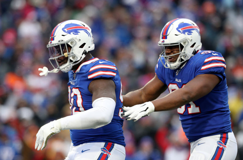 ORCHARD PARK, NEW YORK - NOVEMBER 24: Shaq Lawson #90 of the Buffalo Bills and teammate Ed Oliver #91 celebrate after Lawson made a sack during the third quarter of an NFL game at New Era Field on November 24, 2019 in Orchard Park, New York. Buffalo Bills defeated the Denver Broncos 20-3. (Photo by Bryan M. Bennett/Getty Images)