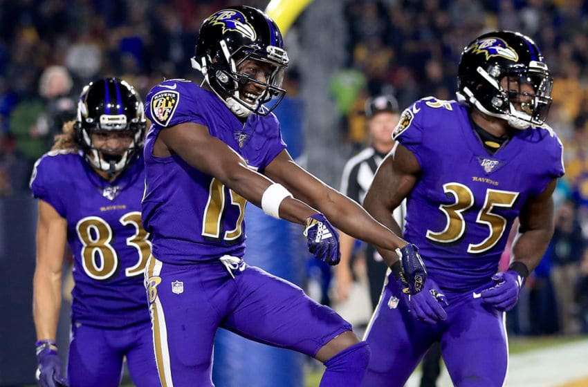 LOS ANGELES, CALIFORNIA - NOVEMBER 25: Wide receiver Marquise Brown #15 of the Baltimore Ravens celebrates his first touchdown in the first quarter of the game against the Los Angeles Rams at Los Angeles Memorial Coliseum on November 25, 2019 in Los Angeles, California. (Photo by Sean M. Haffey/Getty Images)