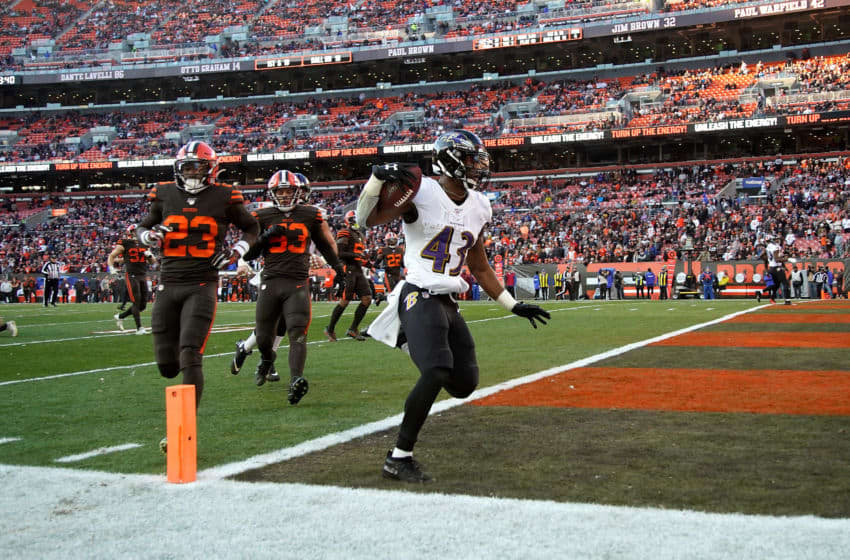 CLEVELAND, OH - DECEMBER 22: Justice Hill #43 of the Baltimore Ravens scores a touchdown during the fourth quarter of the game against the Cleveland Browns at FirstEnergy Stadium on December 22, 2019 in Cleveland, Ohio. Baltimore defeated Cleveland 31-15. (Photo by Kirk Irwin/Getty Images)
