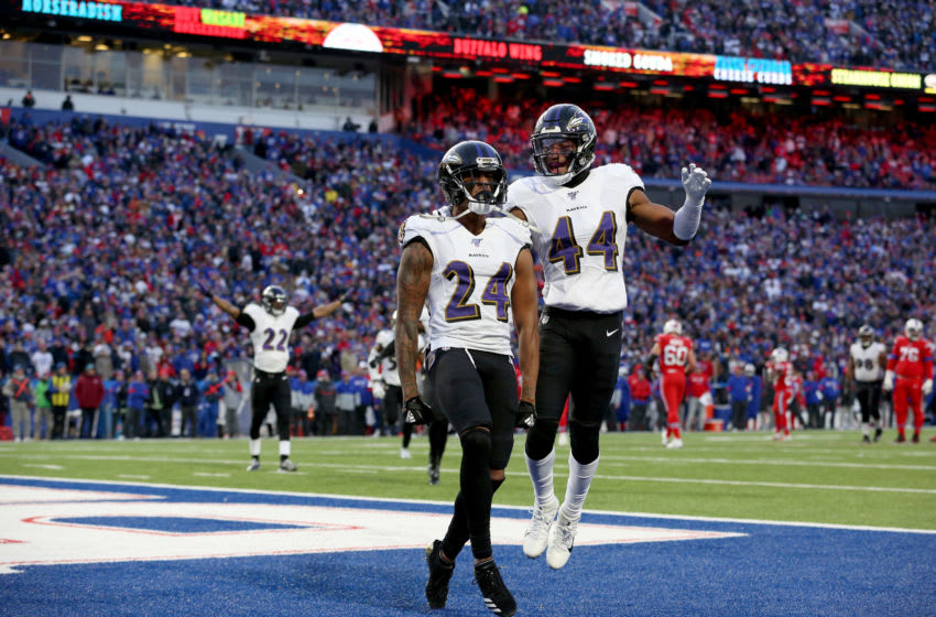 ORCHARD PARK, NEW YORK - DECEMBER 08: Marcus Peters #24 and teammate Marlon Humphrey #44 of the Baltimore Ravens react after breaking up a pass during the fourth quarter of an NFL game against the Buffalo Bills at New Era Field on December 08, 2019 in Orchard Park, New York. (Photo by Bryan M. Bennett/Getty Images)