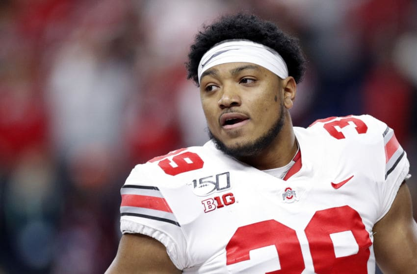 INDIANAPOLIS, IN - DECEMBER 07: Malik Harrison #39 of the Ohio State Buckeyes looks on against the Wisconsin Badgers during the Big Ten Football Championship at Lucas Oil Stadium on December 7, 2019 in Indianapolis, Indiana. Ohio State defeated Wisconsin 34-21. (Photo by Joe Robbins/Getty Images)
