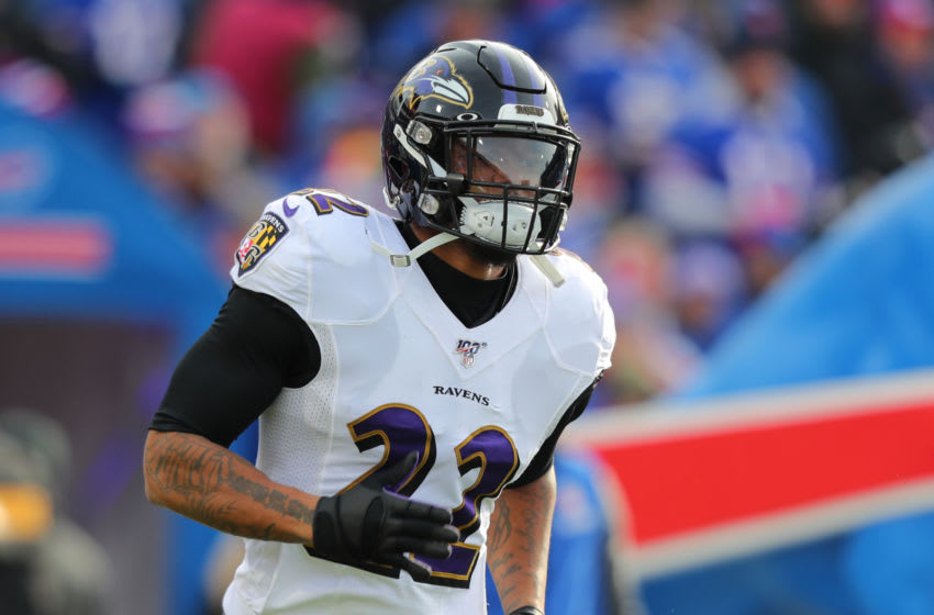ORCHARD PARK, NY - DECEMBER 08: Jimmy Smith #22 of the Baltimore Ravens runs onto the field before a game against the Buffalo Bills at New Era Field on December 8, 2019 in Orchard Park, New York. Baltimore beats Buffalo 24 to 17. (Photo by Timothy T Ludwig/Getty Images)