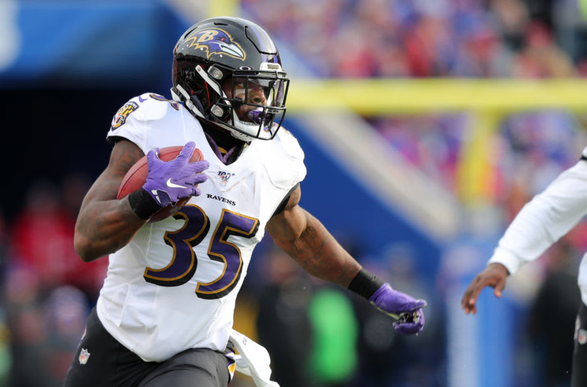 ORCHARD PARK, NY - DECEMBER 08: Gus Edwards #35 of the Baltimore Ravens runs the ball against the Buffalo Bills at New Era Field on December 8, 2019 in Orchard Park, New York. Baltimore beats Buffalo 24 to 17. (Photo by Timothy T Ludwig/Getty Images)