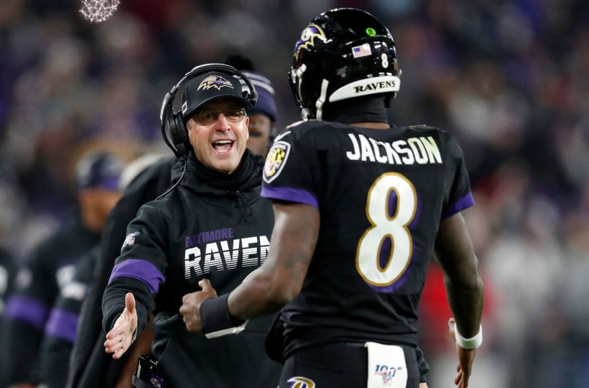 BALTIMORE, MARYLAND - DECEMBER 12: Head coach John Harbaugh of the Baltimore Ravens and quarterback Lamar Jackson #8 celebrate a touchdown in the third quarter of the game against the New York Jets at M&T Bank Stadium on December 12, 2019 in Baltimore, Maryland. (Photo by Scott Taetsch/Getty Images)