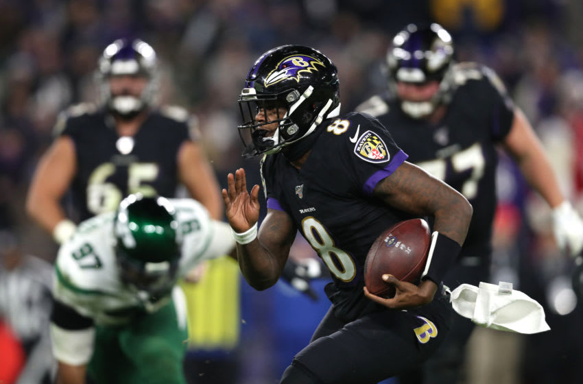 BALTIMORE, MARYLAND - DECEMBER 12: Quarterback Lamar Jackson #8 of the Baltimore Ravens rushes against the New York Jets at M&T Bank Stadium on December 12, 2019 in Baltimore, Maryland. (Photo by Patrick Smith/Getty Images)