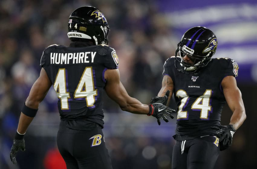 BALTIMORE, MD - DECEMBER 12: Marcus Peters #24 of the Baltimore Ravens celebrates with Marlon Humphrey #44 after a play against the New York Jets during the first half at M&T Bank Stadium on December 12, 2019 in Baltimore, Maryland. (Photo by Scott Taetsch/Getty Images)