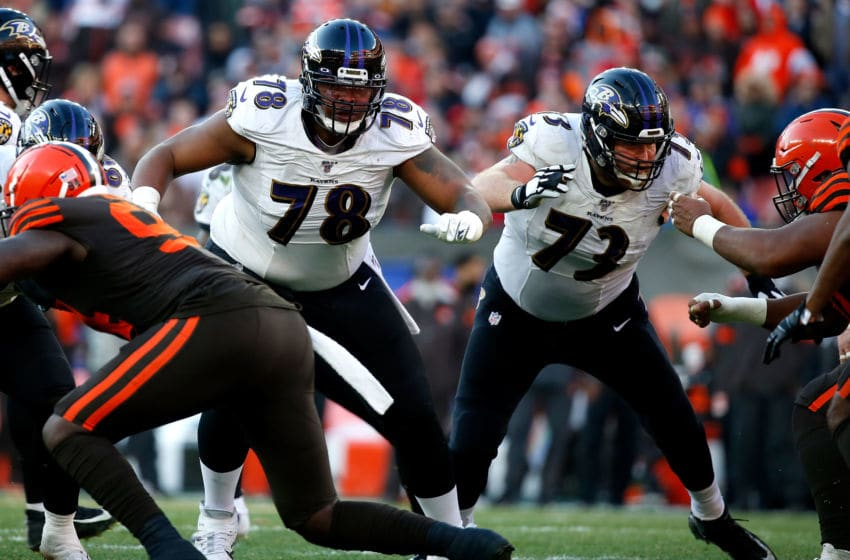 CLEVELAND, OH - DECEMBER 22: Orlando Brown Jr. #78 of the Baltimore Ravens and Marshal Yanda #73 look to make blocks during the game against the Cleveland Browns at FirstEnergy Stadium on December 22, 2019 in Cleveland, Ohio. Baltimore defeated Cleveland 31-15. (Photo by Kirk Irwin/Getty Images)