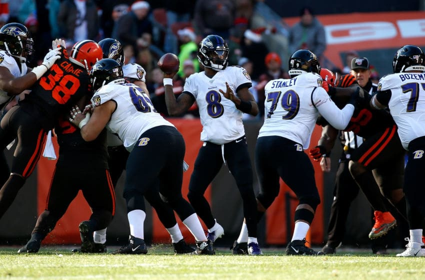 CLEVELAND, OH - DECEMBER 22: Lamar Jackson #8 of the Baltimore Ravens looks to throw the ball during the game against the Cleveland Browns at FirstEnergy Stadium on December 22, 2019 in Cleveland, Ohio. Baltimore defeated Cleveland 31-15. (Photo by Kirk Irwin/Getty Images)